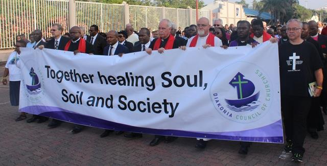 Banner walking with the Elders of the City